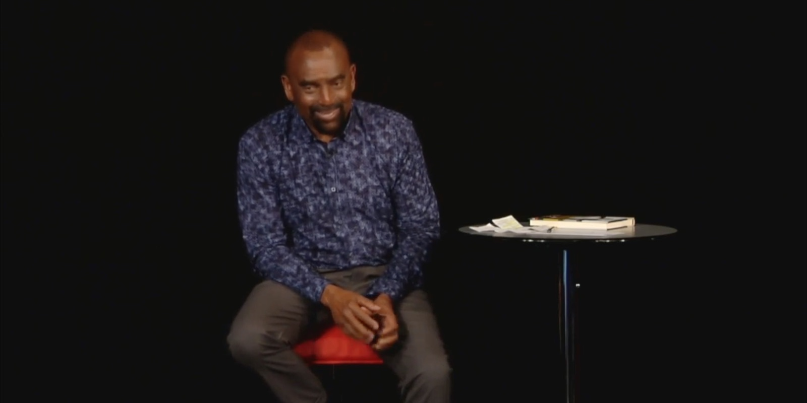 Jesse laughs while talking with the Church congregation
