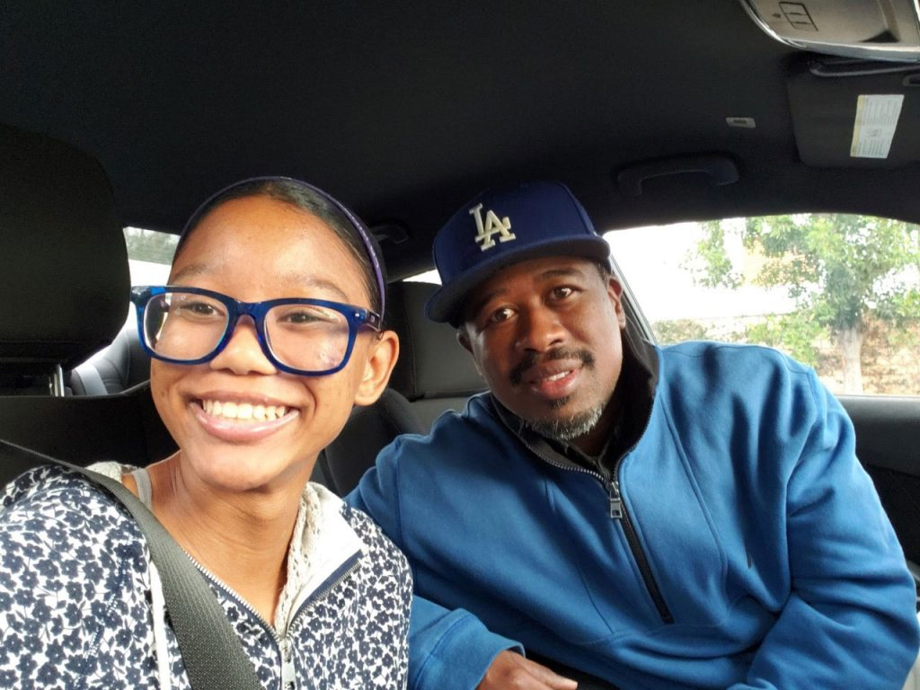 "Zara takes a ""selfie"" with her father Derrick"