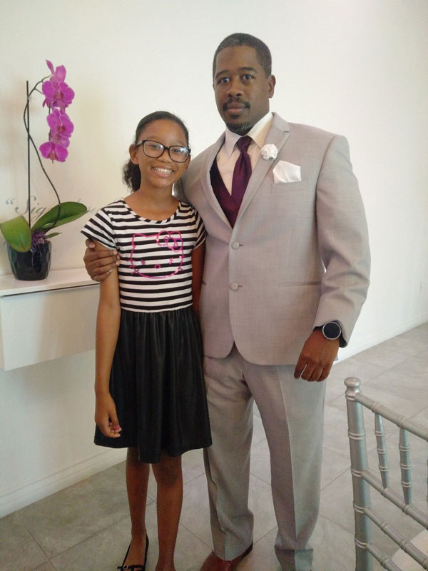 Father and daughter, Derrick and Zara, pose for picture